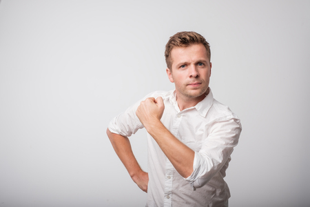 Self-confident middle aged man in white shirt with a clenched fist Stock Photo