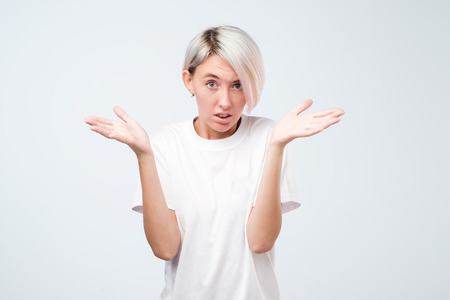 Pretty european girl with short hairstyle do not know what to do