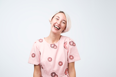 Young european woman in pink funny dress laughing having good positive mood