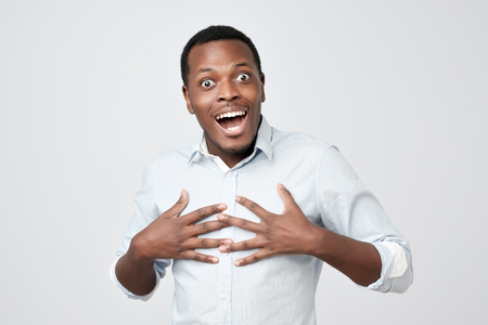 Excited african man smiling and looking at camera
