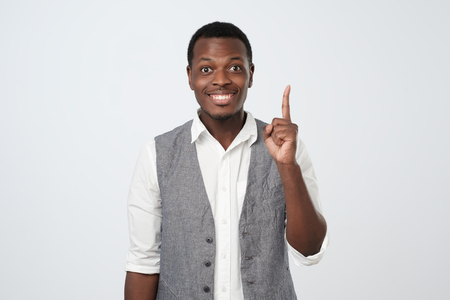 Lucky african man having an idea isolated on a white background