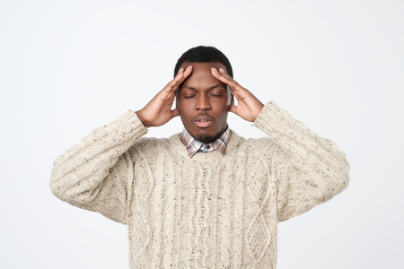 African young man, slapping hand on head having a duh moment isolated on gray background.
