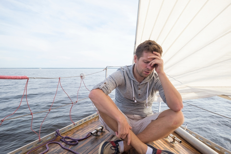 young european man having a nausea seasickness. He is trying to stop vomiting.