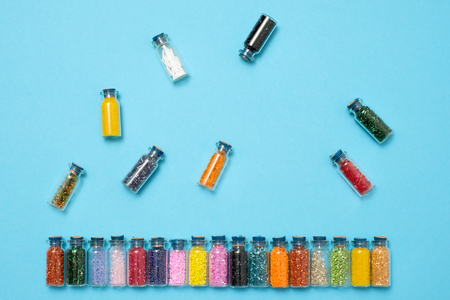 Colored beads in special glass jars. Female or kids hobby