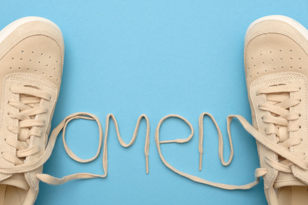 Women sneakers with laces in omen text.