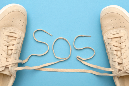 New women sneakers with laces in sos text. Save our souls.