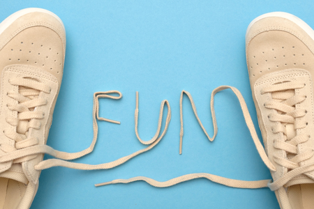 New women sneakers with laces in fun text. Flat lay on blue background. 写真素材