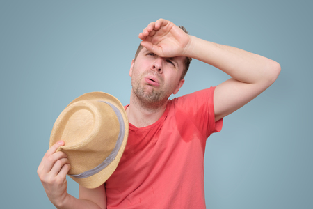 Man is worried and tired because of sweating stain