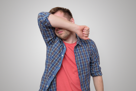 Feeling depressed. Man covering face with hand