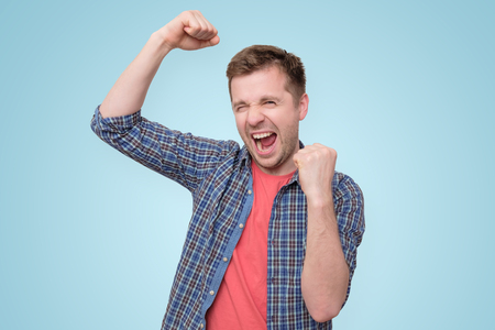 man looking so excited putting his fist up 版權商用圖片