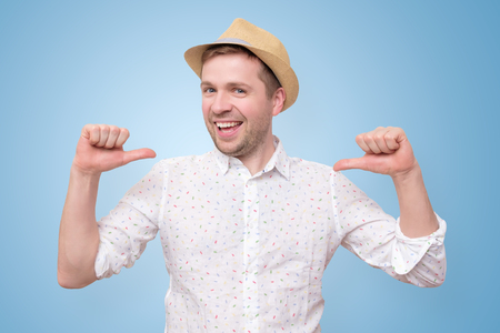 Man in summer hat looking confident with smile on face pointing on himself 版權商用圖片