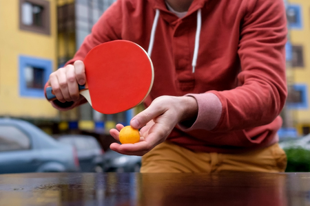 Young caucasian man playing table tennis, ping-pong 版權商用圖片