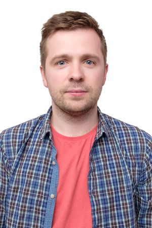 ID picture of a guy in a checked shirt and pink t-shirt
