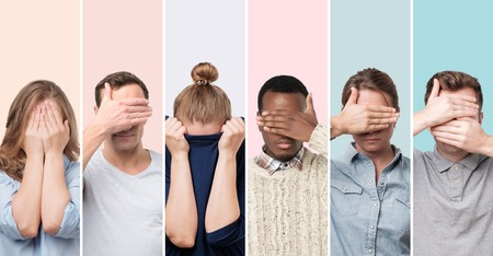Men and women hiding face, wanting to stay anonym