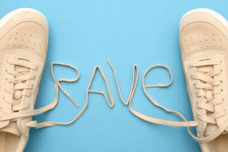 New women sneakers with laces in rave text