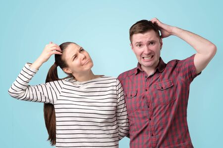 Young couple thinking puzzled about their family budget