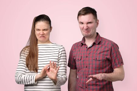 woman and man denying, rejecting proposition, refusing bad deal offer Stock Photo