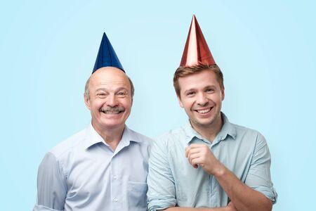 Happy birthday father and son having cheerful look, smiling joyfully