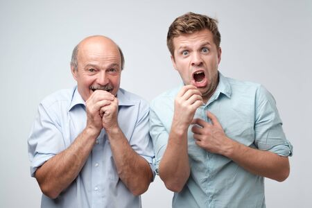 Amazed two mature men is shocked a little with news.