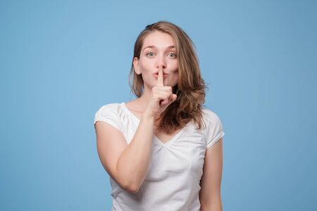 Serious lovely woman asks to keep secret information confidential. Imagens