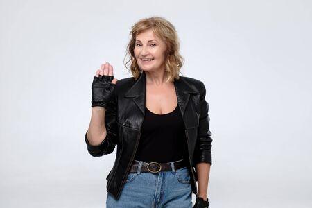 Elderly caucasian woman in black leather jacket. Stockfoto