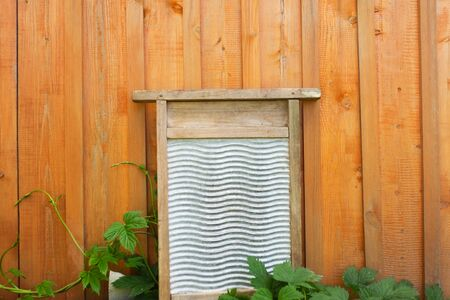 Retro wood and metal washboard used to wash clothes