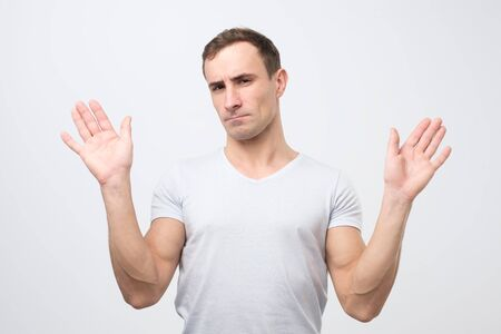 Attractive mature man shows refusal gesture, does not want to participate in meeting