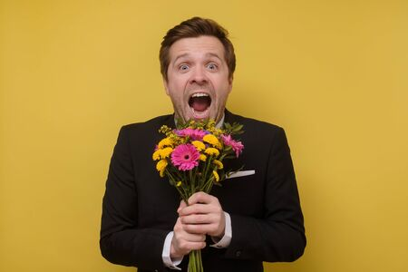 surprised man with flowers for his girlfriend proposing to be his wife