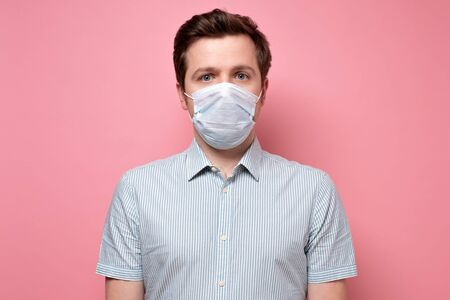 Caucasian young doctor wearing medical mask trying to protect from flu or coronavirus Zdjęcie Seryjne