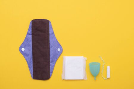 Woman hygiene protection, menstruation, cotton tampons, sanitary pads and menstruation cup Banco de Imagens