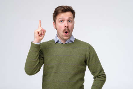 man pointing with finger up having a great idea