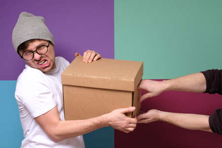 Fight between two men for a box. Stock fotó
