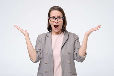 Mature woman in glasses listens to the interlocutor and does not agree with his opinion