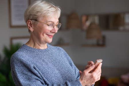 Happy senior woman smiling talking on phone