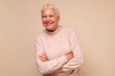 Attractive old caucasian woman, pretty smiling face. Zdjęcie Seryjne