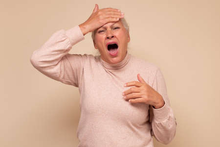 Senior woman with hand on head for mistake, remember error Фото со стока