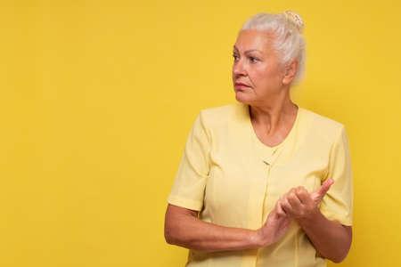 Serious senior hispanic woman looking aside on copyspace