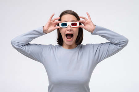 Mature caucasian woman with 3d glasses watching movie.