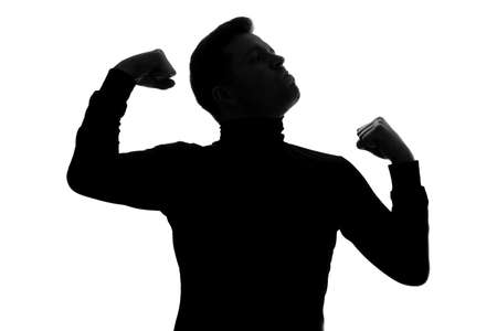 Silhouette of man celebrating his victory or triumph, rejoicing successful deal.