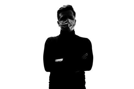 Silhouette of man with medical mask. Protection against coronavirus.