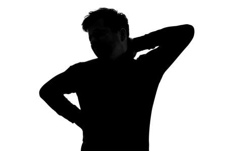 Silhouette of man having neckpain suffering from pain.