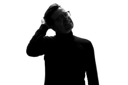 Silhouette of young man having headache isolated over white background.