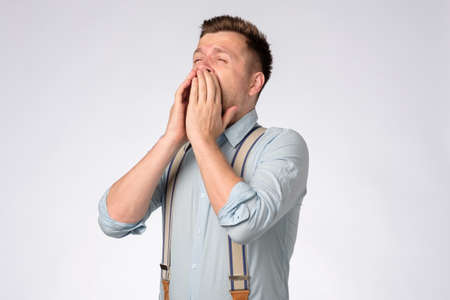 Young man is about to sneeze being ill