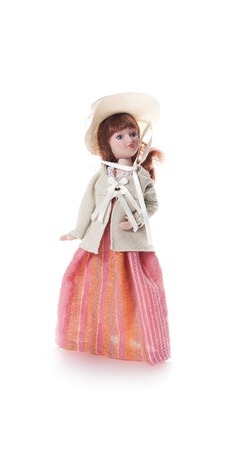 isolated antique doll on white background photo
