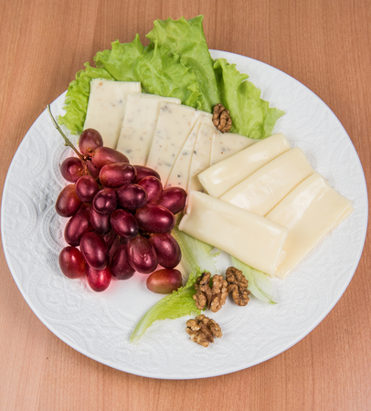 sliced cheese salad and grapes walnut