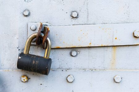 aged rusted metall gate closed steel old padlock for  safety