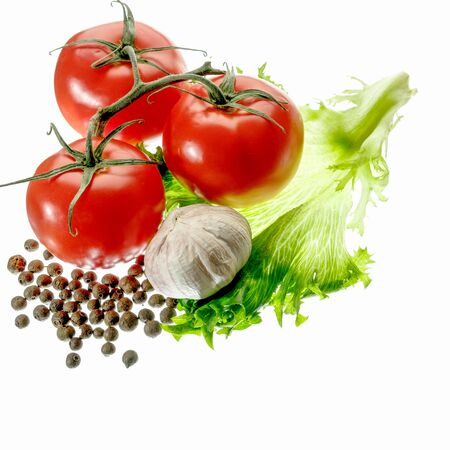 fresh green salad red tomato papper garlic isolated on white background