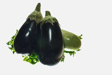 fresh vegetable purple eggplant and green salad isolated on white background 스톡 콘텐츠