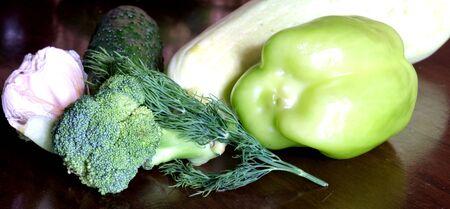 fresh eggplant squash zucchini garlic cucumber paprika on wooden table