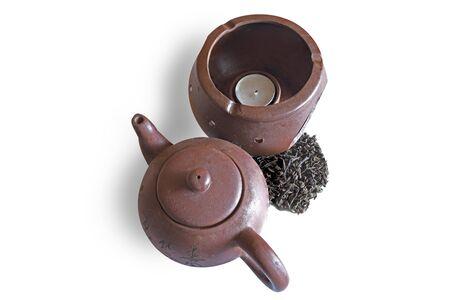 black tea and retro teapot on white background